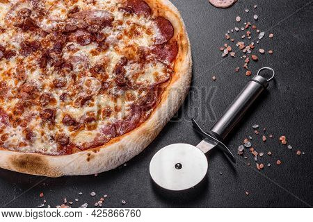 Fresh Delicious Italian Pizza With Four Types Of Meat On A Dark Concrete Background
