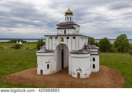 A Reduced Copy Of The Golden Gate Of The City Of Vladimir Stands Among The Meadow