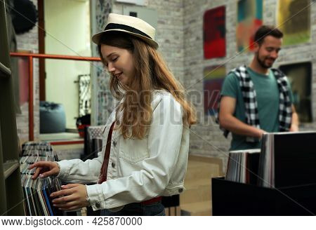 Young People Choosing Vinyl Records In Store