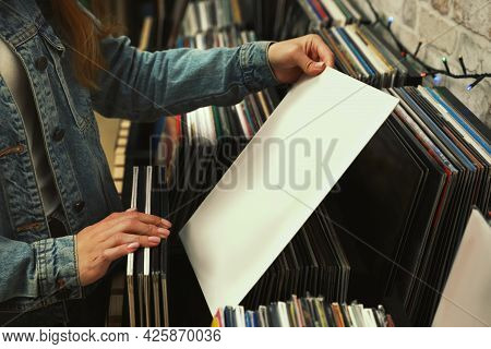 Woman With Vinyl Record In Store, Closeup