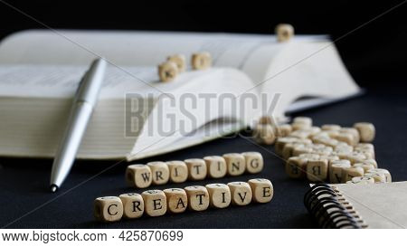Creative Writing Next To Open Textbook, Fountain Pen And Notepad. Concept Of Creative Writing And Te