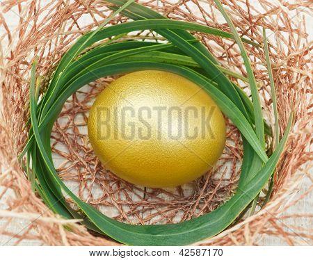 Golden Easter Egg In A Nest.