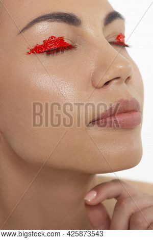 Beautiful Face Of The Woman With Ideal Skin. Evening Bright Cosmetics. Eyelashes Are Long. Red Color