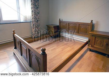 Antique Wooden Bed Frame, Old And Vintage Design. Wooden Bed In Bedroom Old