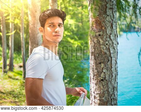 Handsome Young Man On A Lake In A Sunny, Peaceful