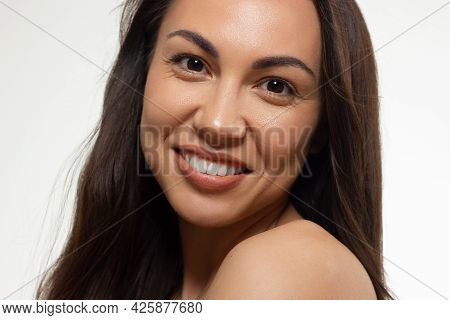 Beauty Closeup Of Women Full Red Lips With Shiny Skin And Long Hair. Facial Skin Care In A Spa Salon