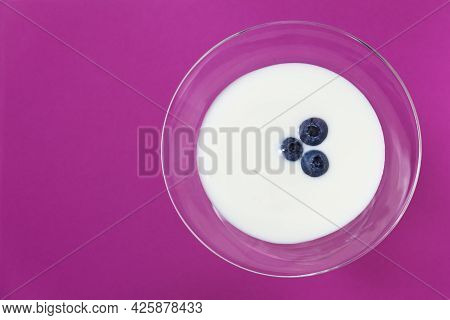 Fresh Yogurt With Blueberries In A Glass On Pink Background As Healthy Breakfast Or Dessert, Taken F