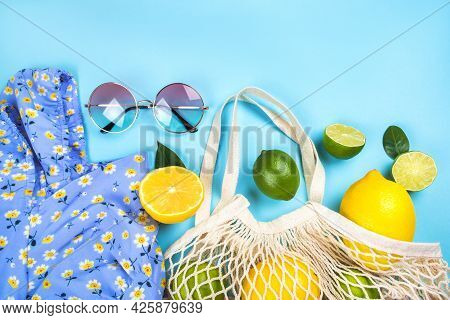 Summer Fashion Flatlay With Printed Dress, Round Gradient Sunglasses And String Mesh Bag With Lemons