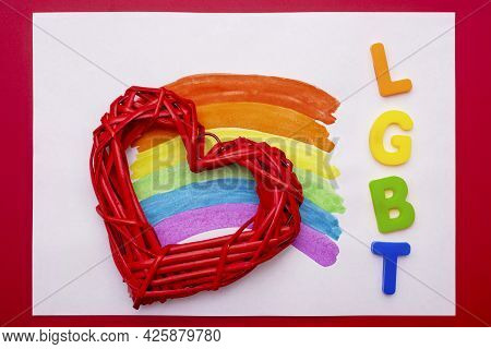 Painted Rainbow On A White Sheet Of Paper With Red Heart And Letters Lgbt.  Lgbt (lesbian, Gay, Bise