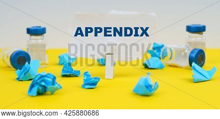 Medicine And Health Concept. On A Yellow Background Are Ampoules, Blue Crumpled Paper And Paper With
