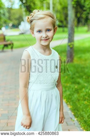 Little Girl In Beautiful Dress Like Princess. Portrait Of Little Princess. Child With Adult Hair Do.