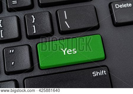 Keyboard With Yes Button. Green Key With Yes Words On A Black Desktop Computer Keyboard. Confirm, Ve