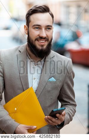 An Ambitious Employee. Elegant Smiling Man In Suit With Beard Outdoors. Successful Businessman, Mode