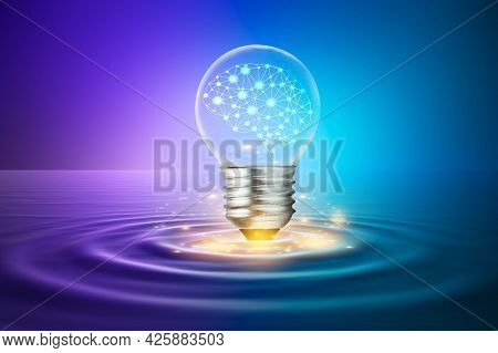 A Light Bulb With A Brain Inside Is Floating Above The Surface. Concepts Using Imagination And Ideas