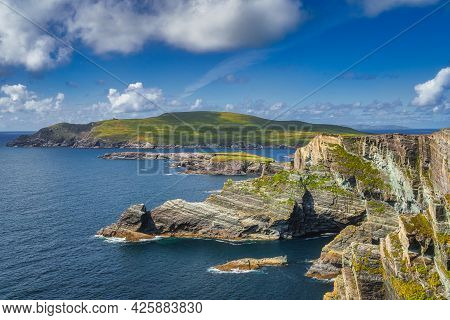 Beautiful Kerry Cliffs Illuminated By Sunlight And A View On Bray Head, Portmagee, Iveragh Peninsula