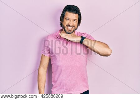 Middle age caucasian man wearing casual white t shirt cutting throat with hand as knife, threaten aggression with furious violence