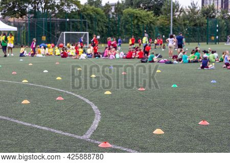 Children Competing During School Sports Day In The Uk. Blurred Image With