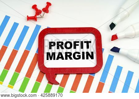 Business And Economy Concept. There Are Markers, Charts And A Sign On The Table - Profit Margin