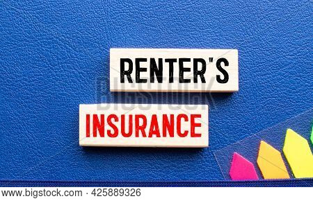 The Word Renter's Insurance Is Written On A Wooden Cubes Structure. Cube On A Bright Background. Can