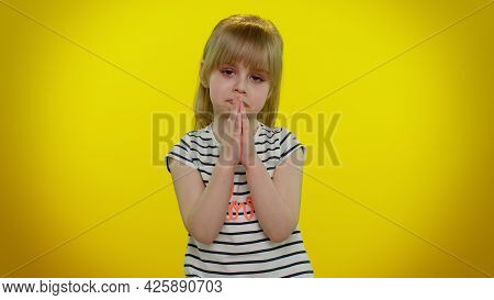 Forgive Me. Little Blonde Teen Kid Child Girl Praying, Looking Upward And Making Wish, Asking With H