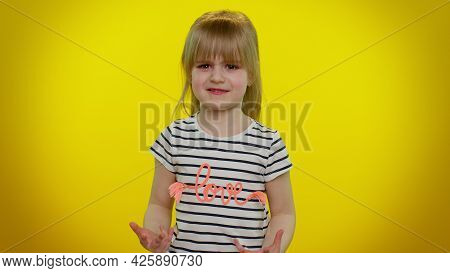 Quarrel. Displeased Blonde Child Girl 5-6 Years Old Gesturing Hands With Irritation And Displeasure,