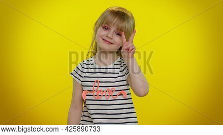 Funny Blonde Kid Child 5-6 Years Old Showing Victory Sign Hoping For Success And Win, Doing Peace Ge