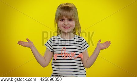 Portrait Of Funny Confused Blonde Child Girl Raising Hands In Indignant Expression, Asking Why, What