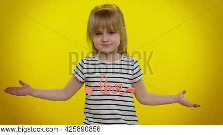 Confused Mad Blonde Child Girl Raising Hands In Indignant Expression, Asking Why, What Reason Of Fai
