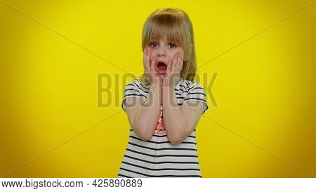 Scared Fearful Blonde Kid Child 5-6 Years Old In T-shirt Expresses His Fear And Waves His Hands Away