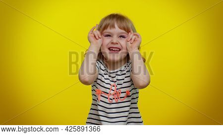 Little Bit Crazy Funny Playful Blonde Kid Child 5-6 Years Old Demonstrating Tongue Out, Fooling Arou