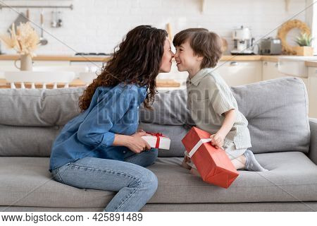 Family Celebrating Birthday, Valentines Day Or Xmas: Cheerful Mom And Son Bonding Sitting On Couch W