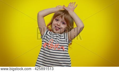 I Am Little Bunny Rabbit. Lovely Funny Teen Kid Child Girl Smiling Friendly And Doing Bunny Ears Ges