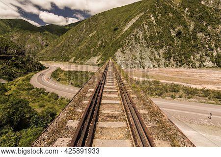 Train Bridge Over A Road Between The Mountains In Salta, Argentina. Tren De Las Nubes (cloud´s Train