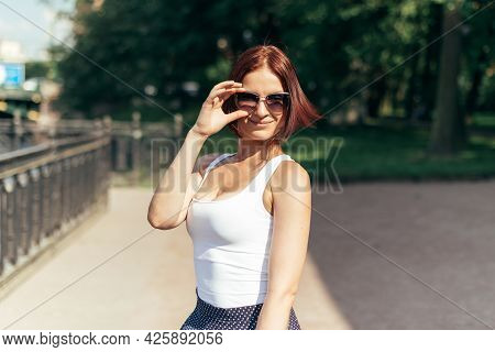 Girl Kakazets With A Bob Hairstyle In Sunglasses In The Park.