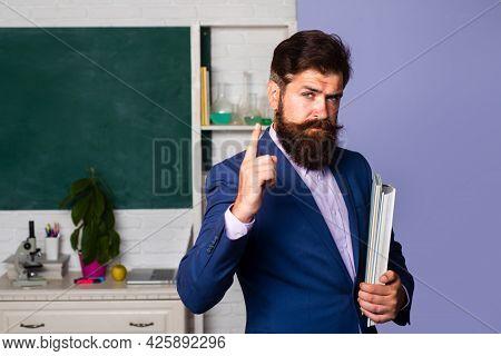 Serious Man Teacher Professor Teaching Student In Classroom. Portrait Of Confident Caucasian Male Te
