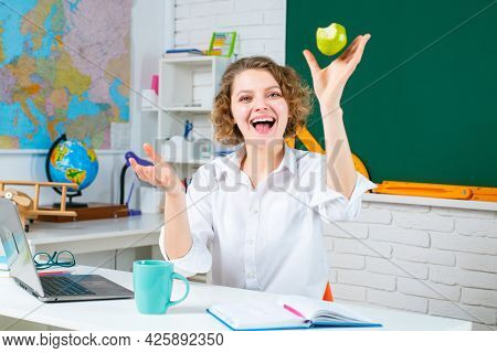 Excited Amazed Teacher. Modern Attractive Teacher. Portrait Of Smart Young Teacher With Book In Clas