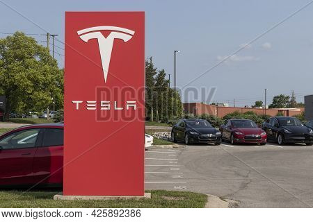 Indianapolis - Circa July 2021: Tesla Electric Vehicles Ev Car And Suv Dealership. Tesla Products In