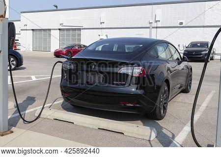 Indianapolis - Circa July 2021: Tesla Electric Vehicles Awaiting Preparation For Sale. Tesla Product