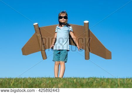 Happy Child Playing With Toy Jetpack. Kid Pilot Having Fun Outdoor. Success Child, Innovation And Le