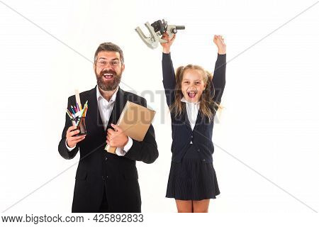 Tutor With School Girl With Successful Exercise Finish. Cheerful Smiling Little Girl In School Unifo