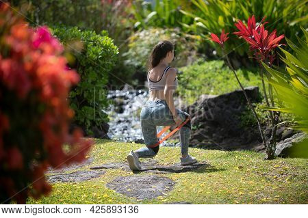 Fitness Woman Doing Glute Bridge Exercise With Resistance Band On Nature. Athletic Girl Working Out