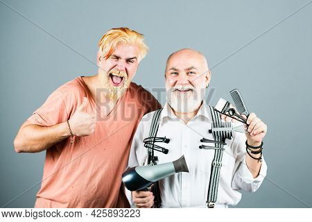 Barber Making Haircut Of Attractive Bearded Man In Barbers Chop. Hair Equipment. Barber With Scissor