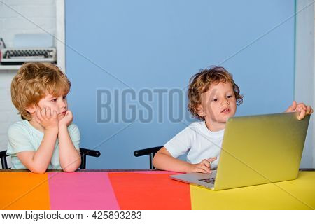 Little Boys Pupils With Happy Face Expression Near Laptop, School Concept. Kids With A Notebook. Por