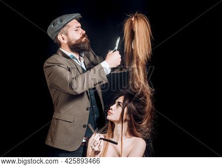 Woman With Long Hair At Beauty Studio. Barber Cutting Hair With Scissors. Fashion Hairdresser Making