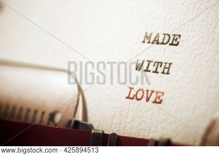 Made with love phrase written with a typewriter.