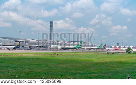 Samut Prakan, Thailand-may 15, 2021 : Cargo Aircraft Parked At The Airport Near Goods Warehouse. Car