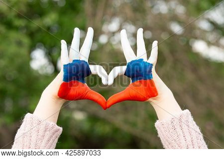 Kid Hands Painted In Russian Flag Color Show Symbol Of Heart And Love Gesture. Heart Shape Of Kids H