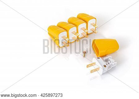 Yellow Electric Connect Plugs Isolated On White Background With Copy Space For Text.