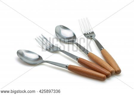 Spoon And Fork Isolated On With Background. Selective Focus.