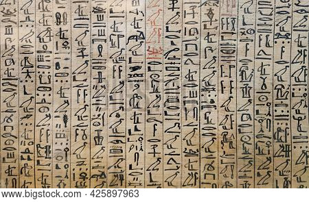 Ancient Egyptian Hieroglyphs And Images Of People On The Papyrus. The Writing Of The Ancient Egyptia